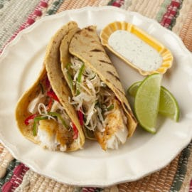 Lemon Pepper Tacos with Jalapeno Slaw & Cilantro Lime Crema